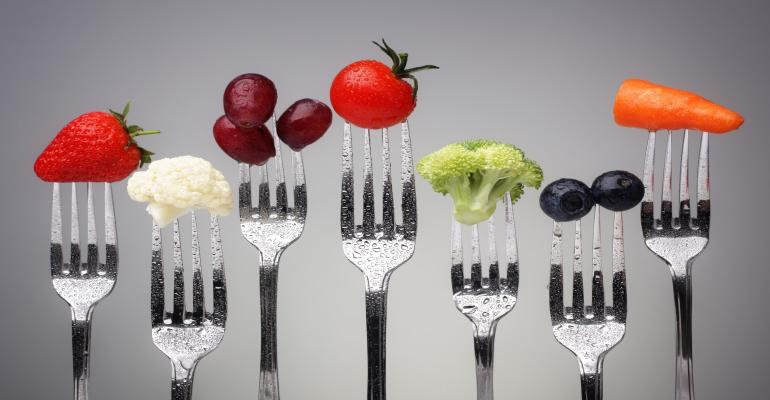 fruits and veggies on forks